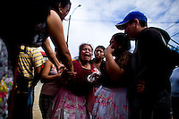 A woman cries for her lost husband at a crime scene of a number 40 P bus line where the pilot was murdered and the assistant was shot in the face by a unknown shooter in zone 7 of Guatemala City Guatemala, 16 January   2009. The number 40 P bus line is of one of the must deadly lines that take the majority of the killings in Guatemala City.