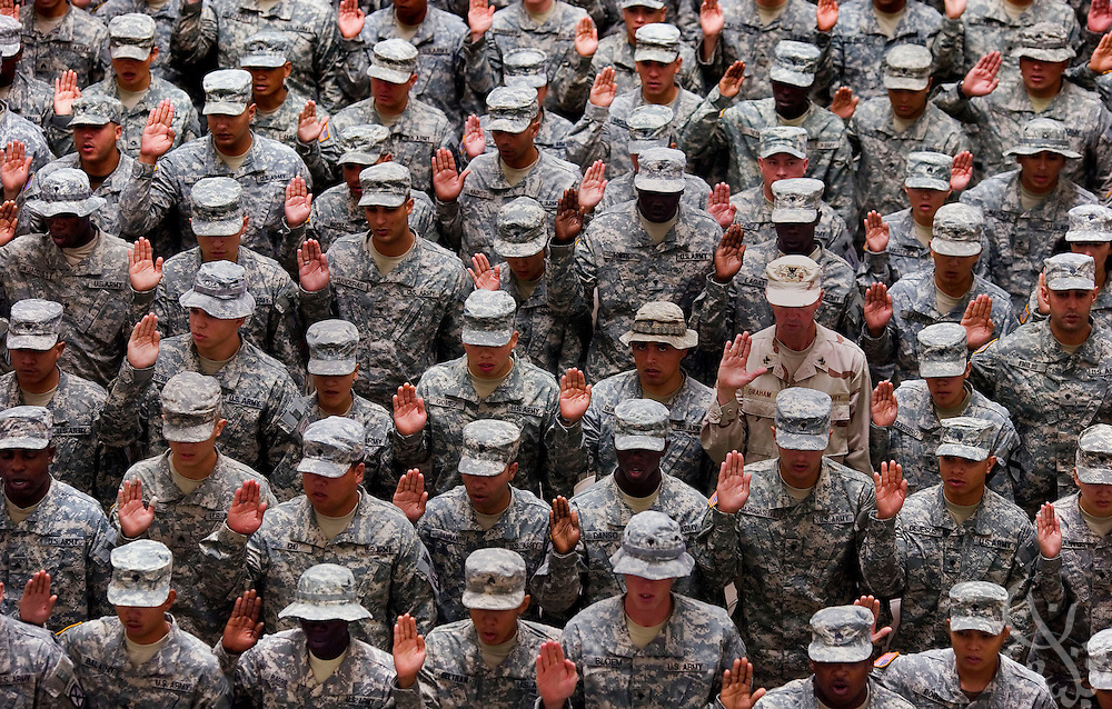 161 U.S. soldiers from 54 countries raise their right hands as they take the oath of allegiance that completes the naturalization process for United States citizenship during a July 4th, 2007 ceremony at Camp Victory in Baghdad, Iraq. In addition to the naturalizations, a further 580 soldiers re-enlisted in the United States military at the ceremony, which was held as part of 4th of July celebrations in Iraq. ...