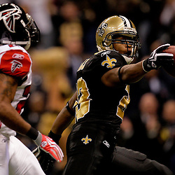 2009 November 02: New Orleans Saints running back Pierre Thomas (23) holds the ball out as he scores on a touchdown past Atlanta Falcons cornerback Tye Hill (24) during the first quarter at the Louisiana Superdome in New Orleans, Louisiana.