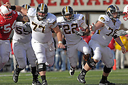 University of Missouri running back Tony Temple (C) rushes between Tiger linemen Adam Spieker (77) and Kurtis Gregory (78) in the second half against Nebraska at Memorial Stadium in Lincoln, Nebraska, November 4, 2006.  The Huskers beat the Tigers 34-20.<br />