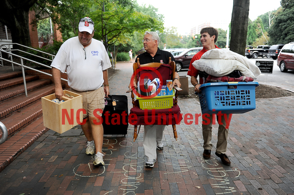 Chancellor Woodson helps a family during move in on Saturday. Photo by Marc Hall