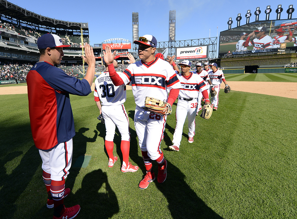 CHICAGO - APRIL 23:  Avisail Garcia #26 and Derek Holland #45 of the Chicago White Sox celebrate after the game against the Cleveland Indians on April 23, 2017 at Guaranteed Rate Field in Chicago, Illinois.  The White Sox defeated the Indians 6-2.  (Photo by Ron Vesely)   Subject:  Avisail Garcia; Derek Holland