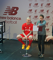 LIVERPOOL, ENGLAND - Friday, April 10, 2015: Liverpool's Martin Skrtel and LFCTV's Claire Rourke during the launch for the New Balance 2015/16 home kit at Anfield. (Pic by David Rawcliffe/Propaganda)