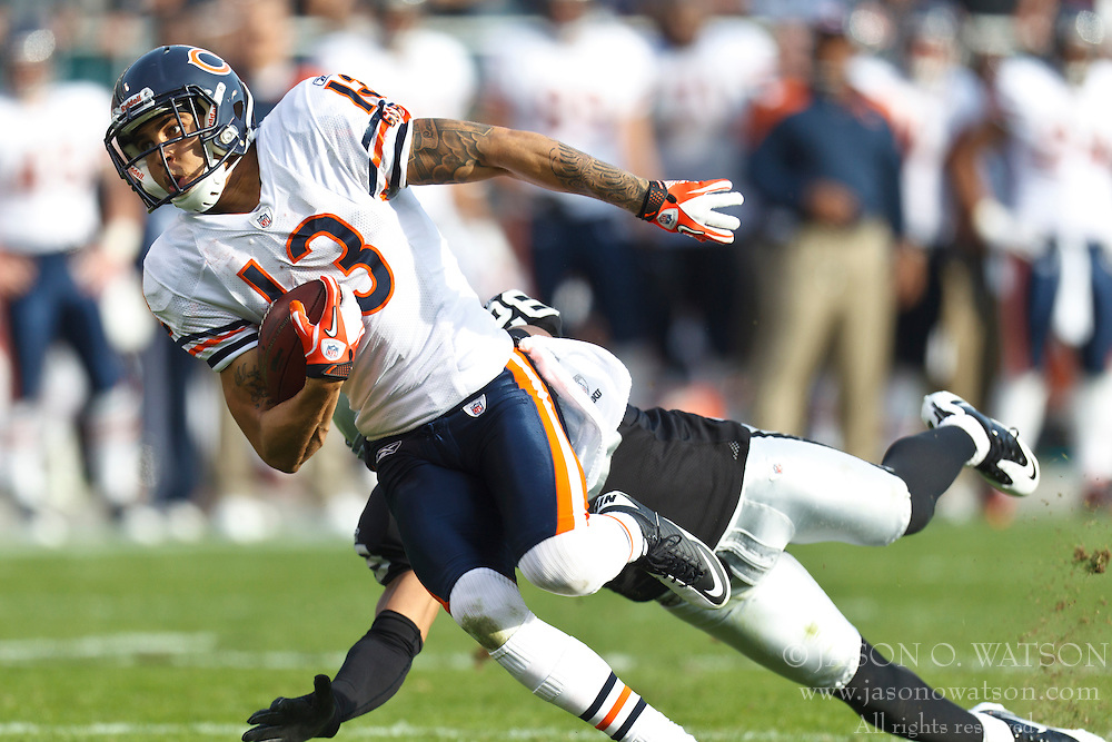 Nov 27, 2011; Oakland, CA, USA; Chicago Bears wide receiver Johnny Knox (13) rushes past Oakland Raiders cornerback Stanford Routt (back) to score a touchdown during the second quarter at O.co Coliseum. Oakland defeated Chicago 25-20. Mandatory Credit: Jason O. Watson-US PRESSWIRE