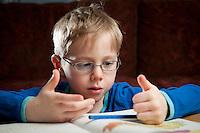 Ari Carl að læra heima. Young boy doing home work.