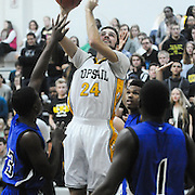 Topsail's Connor Dillion shoots over Trask's Johnathan Jordan, left, and Tynaffii Davis Friday December 5, 2014 at Topsail High School in Hampstead, N.C. (Jason A. Frizzelle)