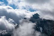 """Mount Mae-Hotaka 3090.5 m / 10,138ft. Karasawa cirque is cradled by the Hotaka Mountains, in the """"Northern Japan Alps"""" (Hida Mountains) in Chubu-Sangaku National Park, Japan. Within the cirque, two lodges provide beds and meals for hikers and climbers: Karasawa Goya and Karasawa Hutte. Also known as Mount Hotaka or Hotaka-dake, the Hotaka Mountains reach 3190 meters elevation atop Mount Oku-Hotaka, Japan's third highest peak. About 2000 meters in diameter, the cirque bottoms out at 2300 m elevation. Snow melting here forms the River Azusa which flows through Kamikochi valley below."""