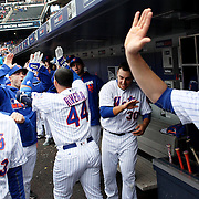 NEW YORK, NEW YORK - MAY 04: New York Mets players and coaches in the dugout congratulate Rene Rivera #44 of the New York Mets as he returns to the dugout after hitting a home run during the Atlanta Braves Vs New York Mets MLB regular season game at Citi Field on May 04, 2016 in New York City. (Photo by Tim Clayton/Corbis via Getty Images)