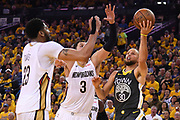 May 1, 2018; Oakland, CA, USA; Golden State Warriors guard Stephen Curry (30) shoots the basketball against New Orleans Pelicans forward Anthony Davis (23) and forward Nikola Mirotic (3) during the third quarter in game two of the second round of the 2018 NBA Playoffs at Oracle Arena. The Warriors defeated the Pelicans 121-116.