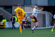 Alan Lithgow (#4) of Livingston FC and Aidan Keena (#35) of Heart of Midlothian FC challenge for the ball during the Ladbrokes Scottish Premiership match between Livingston FC and Heart of Midlothian at the Tony Macaroni Arena, Livingston, Scotland on 26 October 2019.