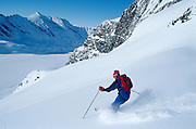 Alaska. Chugach Mts. Stefano Jannuzzo skiing towards a glacier. MR.