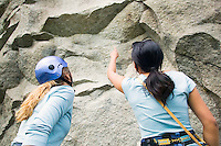 Two female rock climbers preparing to climb&#xA;<br />