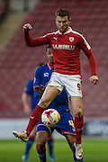 Sam Winnall (Barnsley) jumps for the ball during the Sky Bet League 1 match between Barnsley and Oldham Athletic at Oakwell, Barnsley, England on 12 April 2016. Photo by Mark P Doherty.