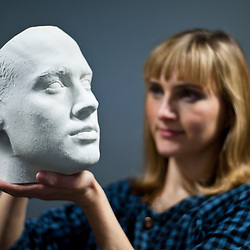 London, UK – 10 October 2013: Kathy Boyce holds a 3D printed head at the Inition demo studio in Shoreditch, East London.