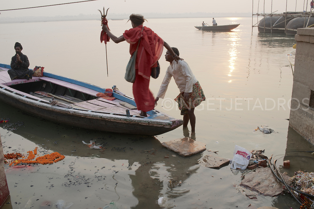 Rahm (L) and Baba G (holding the boatman's shoulder) on their way to the other side of the Ganges River. Varanasi, India.