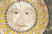 A symbolic Sun. Hand Painted antique wood.