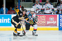 KELOWNA, CANADA - MAY 11: Nick Merkley #10 of Kelowna Rockets is checked by Ivan Provorov #9 of Brandon Wheat Kings during second period on May 11, 2015 during game 3 of the WHL final series at Prospera Place in Kelowna, British Columbia, Canada.  (Photo by Marissa Baecker/Shoot the Breeze)  *** Local Caption *** Ivan Provorov; Nick Merkley;