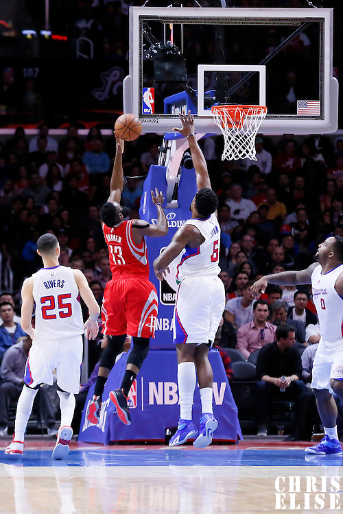 11 February 2015: Houston Rockets guard James Harden (13) goes for the layup past Los Angeles Clippers center DeAndre Jordan (6) during the Los Angeles Clippers 110-95 victory over the Houston Rockets, at the Staples Center, Los Angeles, California, USA.