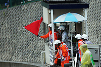 The red flags are waved by marshals as the race is stopped.<br /> Japanese Grand Prix, Sunday 5th October 2014. Suzuka, Japan.