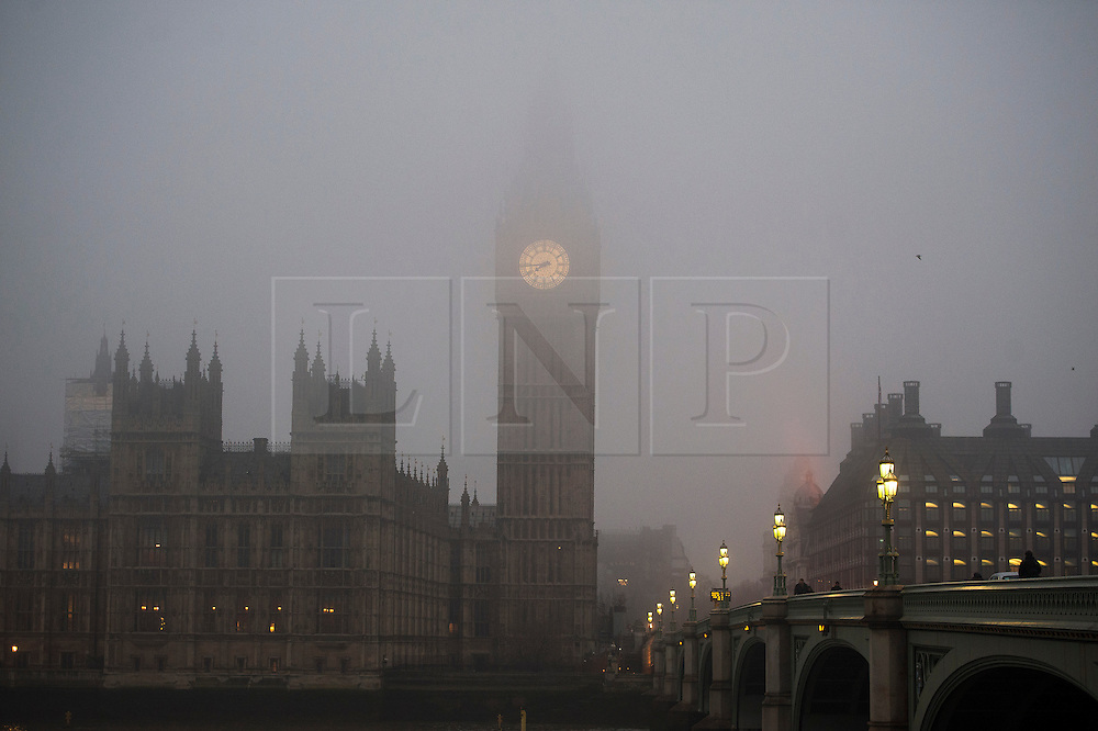© London News Pictures. 21/01/2014. London, UK.  The Big Ben clock tower disappears  into fog, early morning in central London on January 21, 2014. Photo credit: Ben Cawthra/LNP