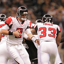 2008 December, 07: Atlanta Falcons quarterback Matt Ryan (2) hands off to running back Michael Turner (33) during a 29-26 victory by the New Orleans Saints over NFC South divisional rivals the Atlanta Falcons at the Louisiana Superdome in New Orleans, LA.