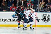 KELOWNA, CANADA - SEPTEMBER 22: Nolan Foote #29 of the Kelowna Rockets back checks Orrin Centazzo #19 of the Kamloops Blazers as he skates with the puck during third period on September 22, 2018 at Prospera Place in Kelowna, British Columbia, Canada.  (Photo by Marissa Baecker/Shoot the Breeze)  *** Local Caption ***