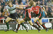 2004/05 Zurich Premiership Rugby - London Irish v Worcester Warriors.Exiles Justin Bishop [left]  attemps to hand of Matt Powell's tackle..07.11.2004 Photo  Peter Spurrier. .email images@intersport-images.com...