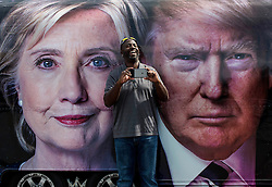 Sept. 26, 2016 - Hempstead, New York, U.S. -  People pose in front of the CNN My Vote camper parked at Hofstra University, site of the first of three scheduled debates between presidential candidates Hillary Clinton and Donald Trump. (Credit Image: © Brian Cahn via ZUMA Wire)