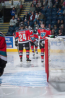 KELOWNA, CANADA - OCTOBER 5:  Jesse Lees #2 and Tyson Baillie #24 of the Kelowna Rockets take part in a pre-game ritual against the Portland Winterhawks  at the Kelowna Rockets on October 5, 2013 at Prospera Place in Kelowna, British Columbia, Canada (Photo by Marissa Baecker/Shoot the Breeze) *** Local Caption ***