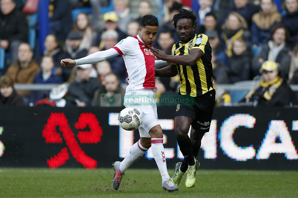 (L-R) Justin Kluivert of Ajax, Fankaty Dabo of Vitesse during the Dutch Eredivisie match between Vitesse Arnhem and Ajax Amsterdam at Gelredome on March 04, 2018 in Arnhem, The Netherlands