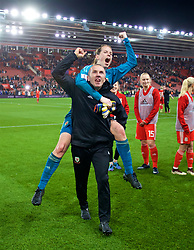 SOUTHAMPTON, ENGLAND - Friday, April 6, 2018: Wales' goalkeeper Laura O'Sullivan and the goalkeeping coach Jon Horton celebrate after a hard fought goal-less draw against England during the FIFA Women's World Cup 2019 Qualifying Round Group 1 match between England and Wales at St. Mary's Stadium. (Pic by David Rawcliffe/Propaganda)