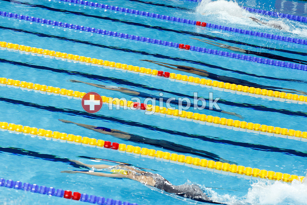 Swimmers of the fifth heat with Inge DEKKER (blue suit) of the Netherlands, Fabian NADARAJAH  (above Dekker) of Austria and Ingvild SNILDAL (below Dekker) of Norway compete in the women's 50m Butterfly Heats at the 13th European Short Course Swimming Championships in Istanbul, Turkey, Friday, Dec. 11, 2009. (Photo by Patrick B. Kraemer / MAGICPBK)