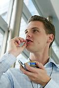 BRUSSELS - BELGIUM  -27 AUGUST 2004--Swedish MEP Christofer FJELLNER with mouth tobacco, the Swedish Snus.--PHOTO: ERIK LUNTANG