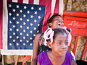 18 NOVEMBER 2010 - PORT-AU-PRINCE, HAITI: A girl and her mother in a tent city camp in Port-au-Prince for people displaced by the earthquake. The woman laughed at reports of cholera in Port-au-Prince and said she wasn't afraid of the disease. An outbreak of cholera in northern Haiti about a month ago has spread across the nation. Tens of thousands of people have been hospitalized and treated for cholera and more than 1,100 have died. Cholera is a water borne illness that causes severe diarrhea and death by dehydration in a matter of hours.   PHOTO BY JACK KURTZ  choleraepidemic