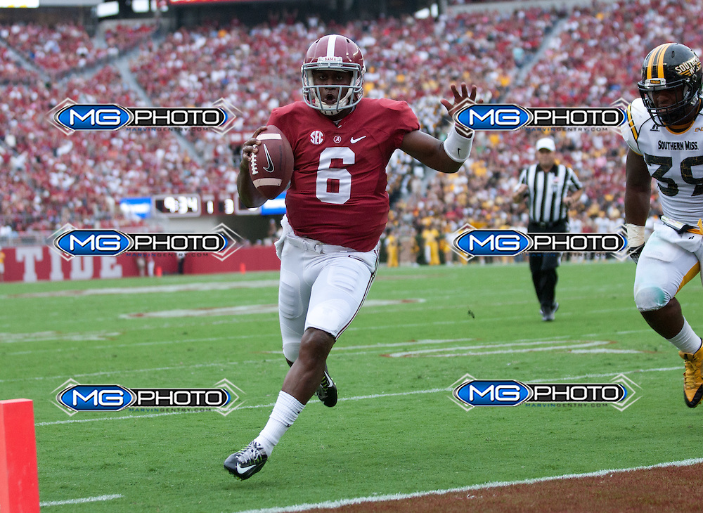 Sep 13, 2014; Tuscaloosa, AL, USA; Alabama Crimson Tide quarterback Blake Sims (6) scores a touchdown against Southern Miss Golden Eagles at Bryant-Denny Stadium. Mandatory Credit: Marvin Gentry-USA TODAY Sports