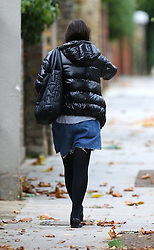 Sadie Frost wearing a short puffa jacket, grey t-shirt, pair of cut-down denim shorts, black tights and brogue shoes with no shoelaces, was spotted enjoying a packet of crisps in north London, UK. 02/10/2012<br />