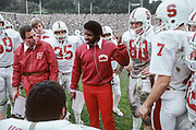 BERKELEY, CA - NOVEMBER 22:  Dennis Green, Stanford University Offensive Coordinator, coaches during the 1980 Big Game between Stanford and the California Golden Bears played November 22, 1980 at Memorial Stadium in Berkeley, California.  Also visible are assistant coach Dick James, Chris Dressel #88, and John Elway #7. (Photo by David Madison/Getty Images)