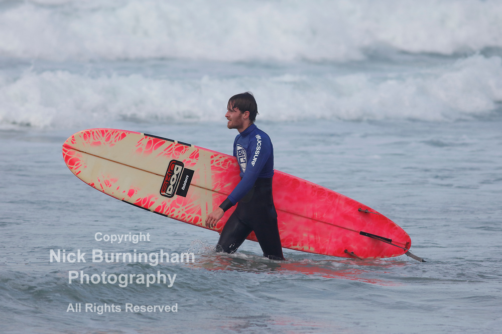 Fistral Beach, Newquay, Cornwall, UK. 13th October, 2017. Surfers take part in Day 1 heats of the British University and College Sports Surfing Competition. Numerous college surfers attended the event in fair weather conditions.