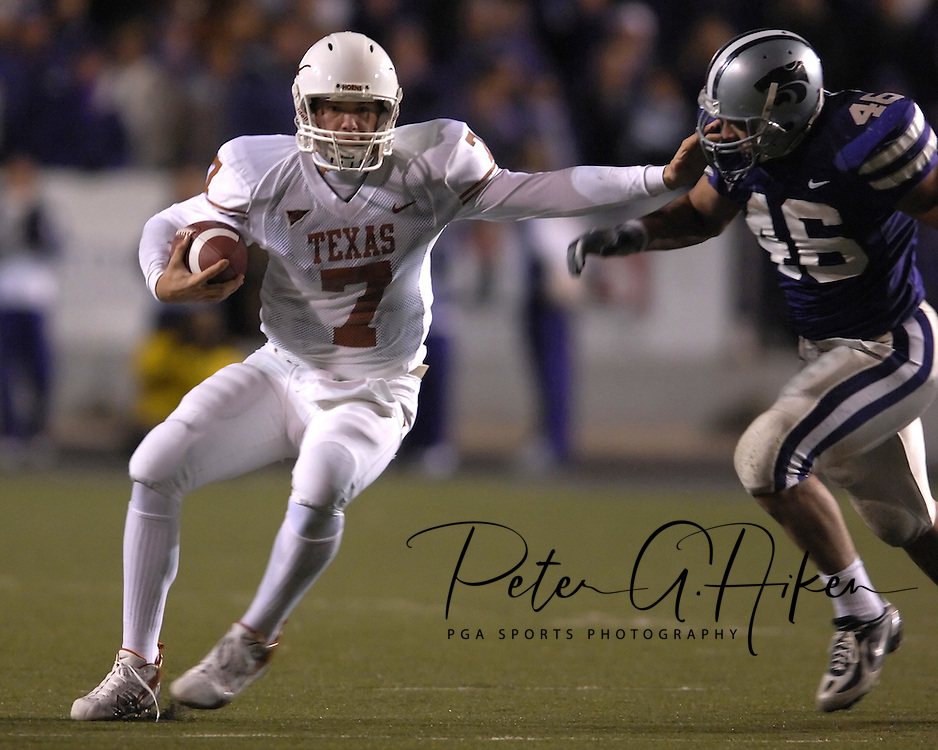 University of Texas quarterback Jevan Snead (7) puts out a stiff arm as he rushes down field against Kansas State linebacker Brandon Archer (46) in the second half at Bill Snyder Family Stadium in Manhattan, Kansas, November 11, 2006.  The Wildcats upset 4th ranked Texas 45-42.<br />