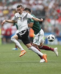 MOSCOW, June 17, 2018  Julian Draxler (L) of Germany vies with Carlos Salcedo of Mexico during a group F match between Germany and Mexico at the 2018 FIFA World Cup in Moscow, Russia, June 17, 2018. (Credit Image: © Cao Can/Xinhua via ZUMA Wire)