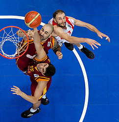 Predrag Samardziski and Pero Antic of Macedonia vs Viktor Sanikidze of Georgia during basketball game between National basketball teams of  Georgia and Former Yugoslav Republic of Macedonia at FIBA Europe Eurobasket Lithuania 2011, on September 8, 2011, in Siemens Arena,  Vilnius, Lithuania. (Photo by Vid Ponikvar / Sportida)
