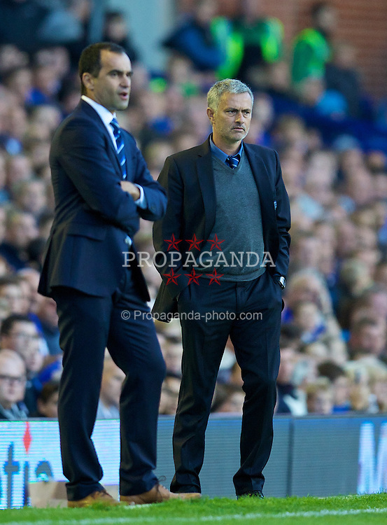 LIVERPOOL, ENGLAND - Saturday, September 14, 2013: Chelsea's manager Jose Mourinho and Everton's manager Roberto Martinez during the Premiership match at Goodison Park. (Pic by David Rawcliffe/Propaganda)