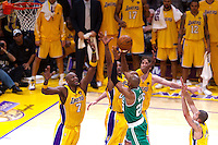 17 June 2010: Guard Ray Allen of the Boston Celtics shoots the ball while being guarded by (7) Lamar Odom, (24) Kobe Bryant, and (16) Pau Gasol of the Los Angeles Lakers during the second half of the Lakers 83-79 championship victory over the Celtics in Game 7 of the NBA Finals at the STAPLES Center in Los Angeles, CA.