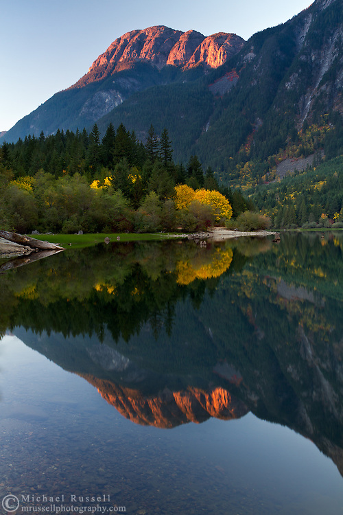 Hope Mountain alpenglow is reflected in Silver Lake at Silver Lake Provincial Park near Hope, British Columbia, Canada