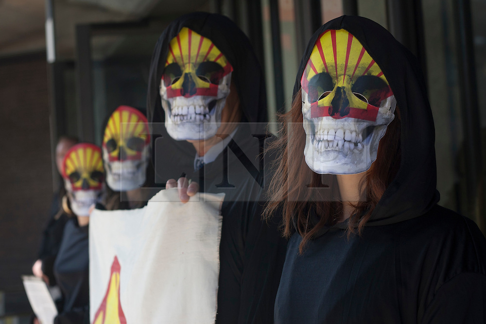 © licensed to London News Pictures. London, UK 22/05/2012. Protesters from Rising Tide posing outside Shell's AGM in Barbican, today (22/05/12). Photo credit: Tolga Akmen/LNP