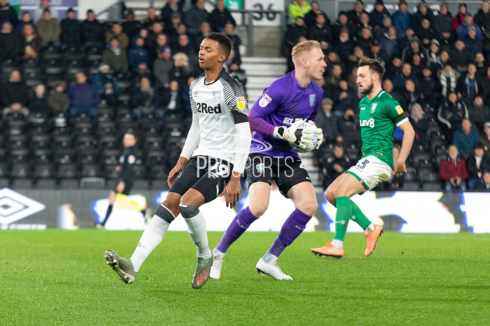 Chris Martin (19) is beaten to the ball by Cameron Dawson (25) during the EFL Sky Bet Championship match between Derby County and Sheffield Wednesday at the Pride Park, Derby, England on 11 December 2019.
