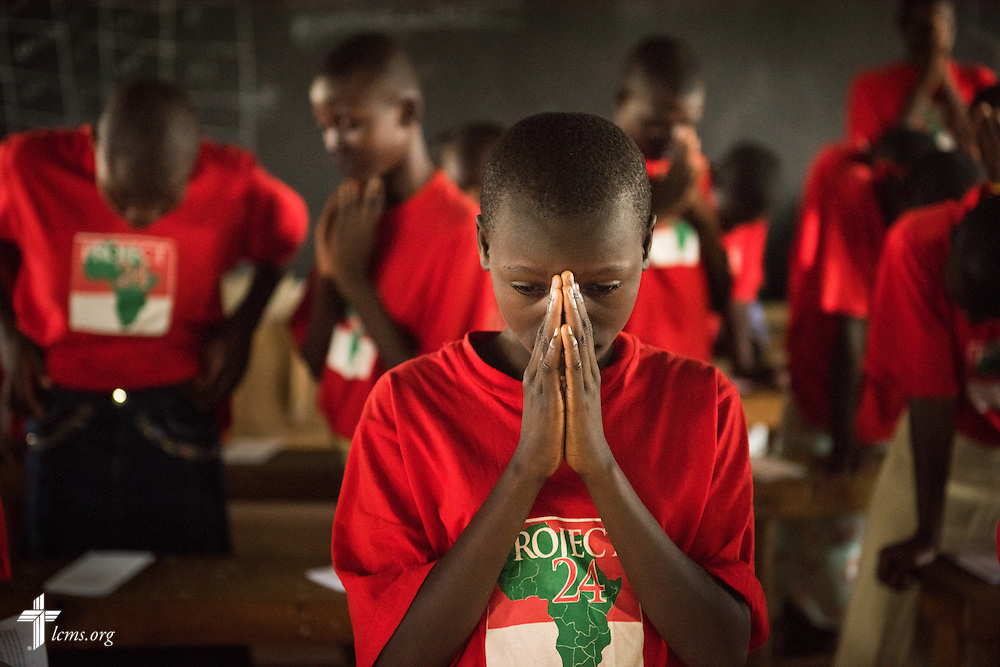 Young ladies pray during catechism class at the Tumaini ELCK (Evangelical Lutheran Church in Kenya) Project 24 boarding facility on Sunday, Oct. 18, 2015, in Kisumu, Kenya. LCMS Communications/Erik M. Lunsford