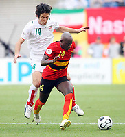 Photo: Chris Ratcliffe.<br /> <br /> Iran v Angola. FIFA World Cup 2006. 21/06/2006.<br /> <br /> Mendonca of Angola clashes with Andranik Teymourian of Iran.