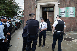 © Licensed to London News Pictures. 19/09/2018. London, UK. Police arrive at the entrance to The Hussaini Association Islamic Centre in Cricklewood, north London where a car hit two pedestrians last night. The incident , which took place in the early hours of this morning outside the centre, is being treated as a possible hate crime. Police are looking for a male driver who failed to stop at the scene, as well as two men and one woman in the car, all in their 20s. Photo credit: Peter Macdiarmid/LNP