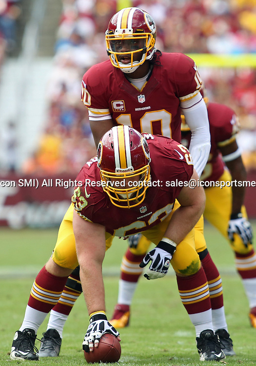 September 22, 2013: Washington Redskins Quarterback Robert Griffin III (10) awaits the snap Washington Redskins Center/Guard Will Montgomery (63) during a regular season match between the Detroit Lions and the Washington Redskins at FedEx Field in Landover, Maryland.